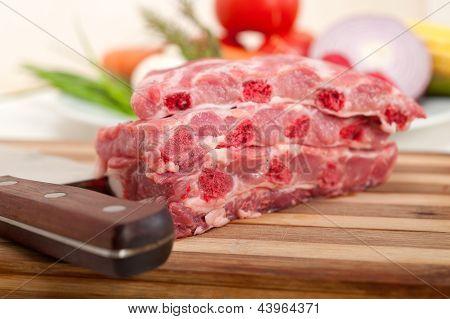 Chopping Fresh Pork Ribs And Vegetables