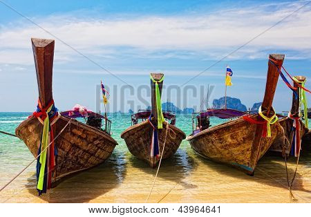 Traditional longtail boats in Railay beach Thailand