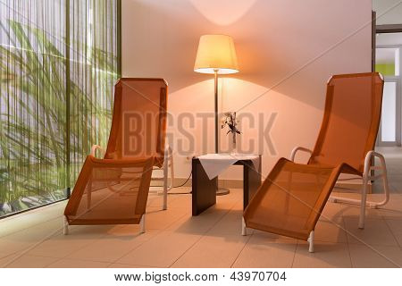 two sunloungers with lamp