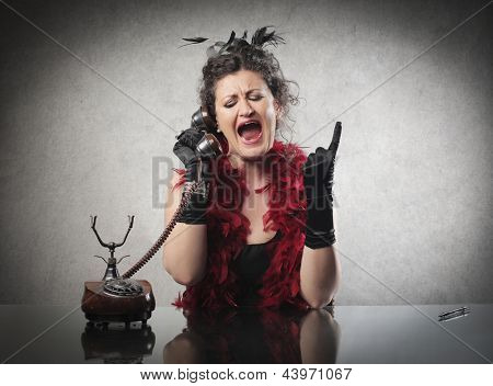 angry woman speaks to the telephone