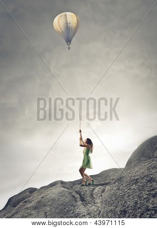 young woman pulls hot air balloon