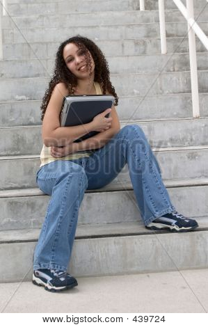 Latin Student Hugging Computer