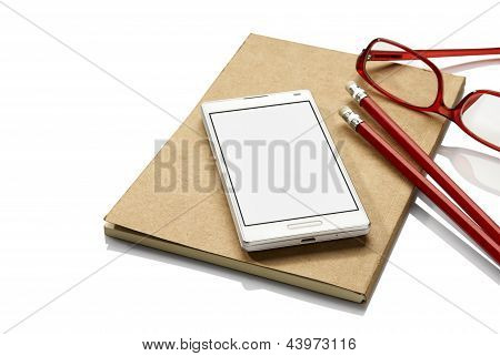 Notebook, Phone And Glasses