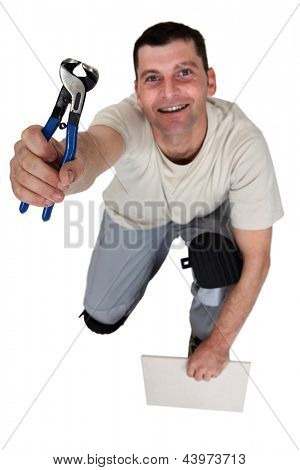 Worker with a pair of pincers