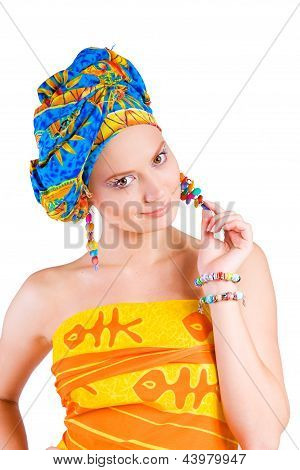 beautiful smiling girl in cilorful clothes holding her earring