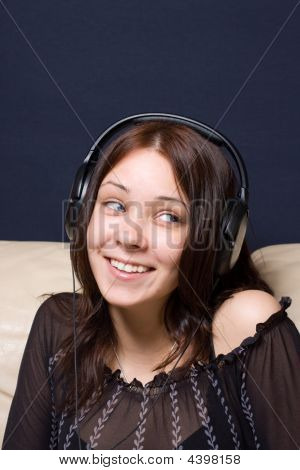 The Beautiful Girl Listens To Music