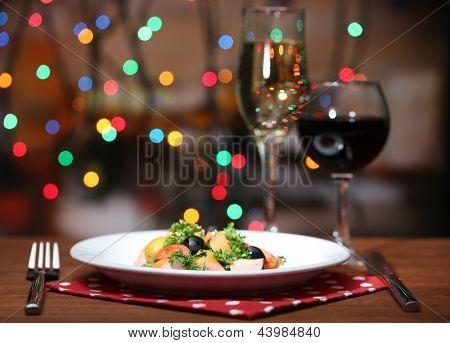 Tasty salad on dark background with bokeh  defocused lights