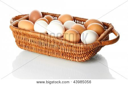 Many eggs in basket isolated on white