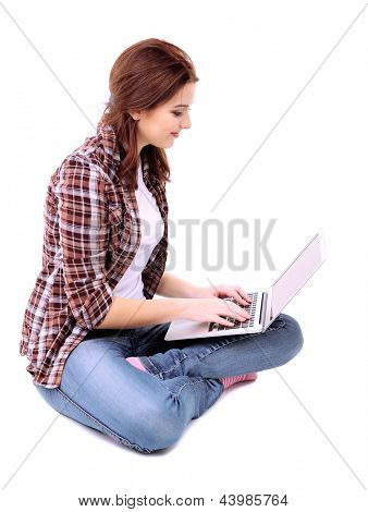 Beautiful young woman with laptop  isolated on white