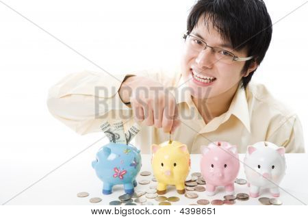 Asian Businessman Saving Money
