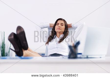 Young businesswoman relaxing at office