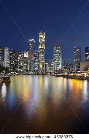Singapore Skyline By Boat Quay Vertical