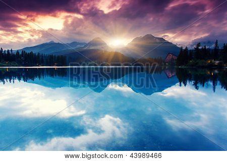 Mountain lake in National Park High Tatra. Dramatic overcast sky. Strbske pleso, Slovakia, Europe. Beauty world.