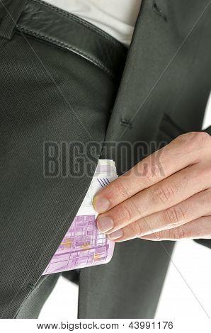 Man Putting 500 Euro Banknotes In His Pocket