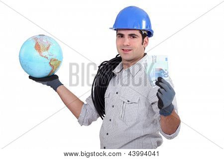 Electrician holding globe and cash