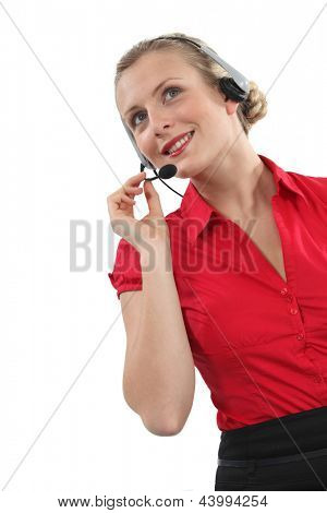 Peppy woman wearing a headset