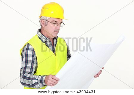 Foreman looking at plans