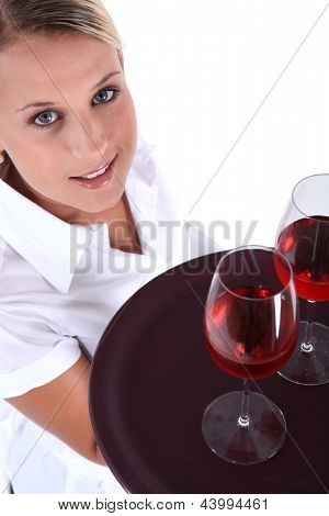Waitress serving two glasses of wine