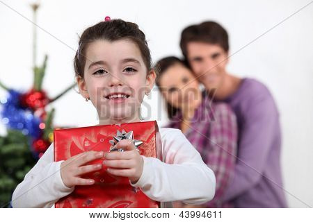 Young girl with a Christmas present