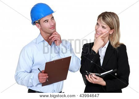 Architect and builder thinking about the same thing