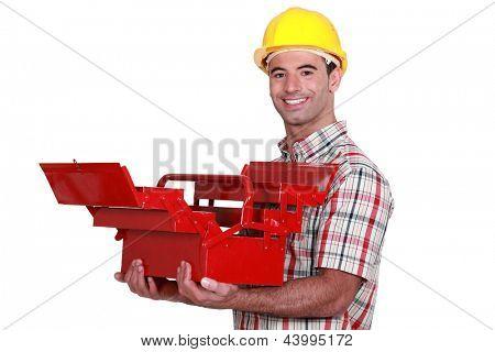 Trabalhador com uma caixa de ferramentas aberta