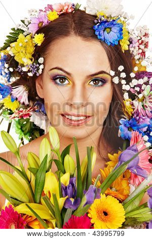 Face of woman with make up and flower. Isolated.