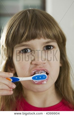 Little Girl Cleaning Teeth
