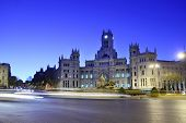 stock photo of neo-classic  - Post Office Building and fountain at Cibeles Square at morning in Madrid - JPG