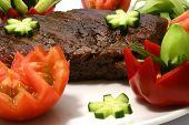 picture of pork chop  - roast meat and vegetables on white dish - JPG