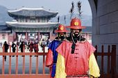 SEOUL - FEBRUARY 14: Guards at Gwanghwamun Gate, the entrance of Gyeongbokgung Palace February 14, 2