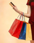 pic of overspending  - closeup or picture of woman with shopping bags  - JPG
