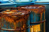 stock photo of dump  - Several barrels of toxic waste at the dump - JPG