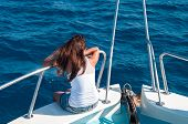 Brunette On Shipboard Of Yacht With Legs Out. Copyspace