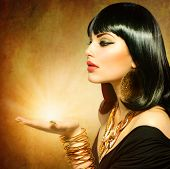 stock photo of nail-design  - Egyptian Style Woman with Magic Light in Her Hand - JPG