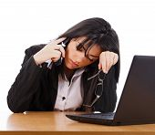 foto of grieving  - Tired business woman answering the telephone holding glasses - JPG