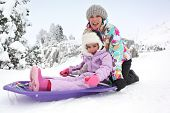 picture of toboggan  - Mother and daughter sledging - JPG