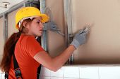 pic of interior decorator  - Female electrician at work - JPG