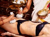 stock photo of panchakarma  - Young woman having feet Ayurveda spa massage - JPG