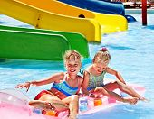 picture of inflatable slide  - Child on water slide at aquapark - JPG