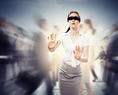 foto of confuse  - Image of businesswoman in blindfold walking among group of people - JPG