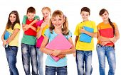 image of classmates  - Group of happy teen school child with book - JPG