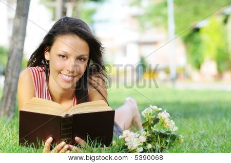 Young Woman In Green Park, Book And Reading