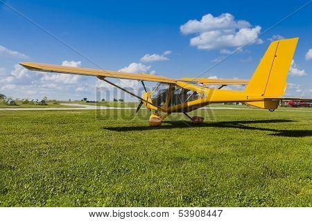 Yellow two-seater mini plane
