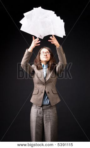 Young Businesswoman Throwing Up Heap Of Papers