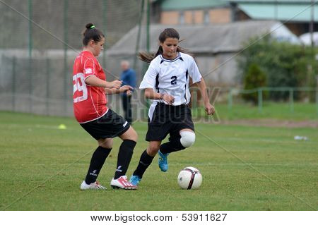KAPOSVAR, HUNGARY - NOVEMBER 3: Dorisz Druzsin (in white) in action at  a Hungarian Championship under 15 women soccer game Rakoczi FC (white) vs Pecsi MFC (red) November 3, 2013 in Kaposvar, Hungary.