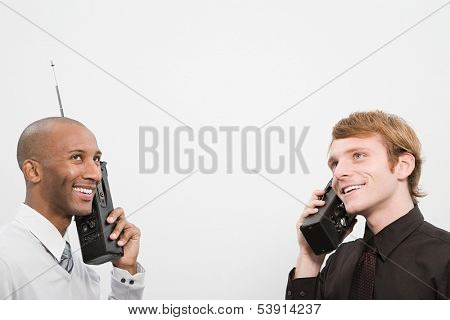 Two men using walkie talkies