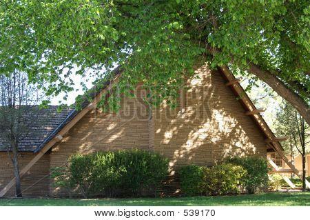 Triangular Stone/brick Church With Cross