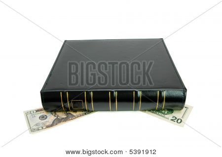 Black Book Presses Down Twenty Dollar Bills Isolated