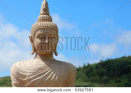 Buddha Image With Blue Sky In Background
