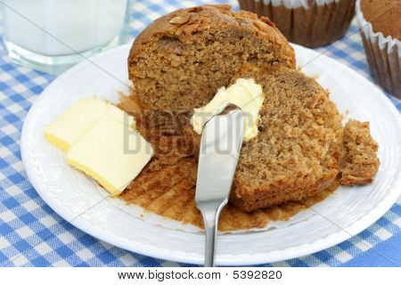 Cut Oat Bran Muffin With Butter And Milk.